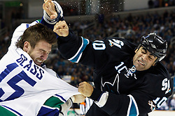 January 3, 2011; San Jose, CA, USA;  San Jose Sharks center Jamal Mayers (right) punches Vancouver Canucks center Tanner Glass (15) during the first period at HP Pavilion.