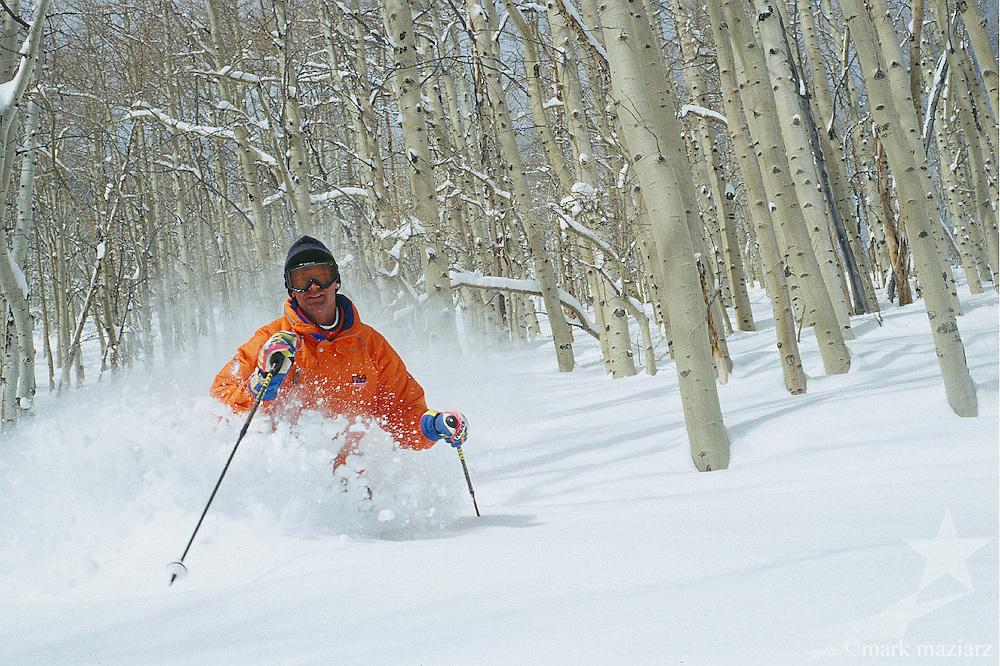 Murray skiing trees at The Canyons, Park City, Utah, USA