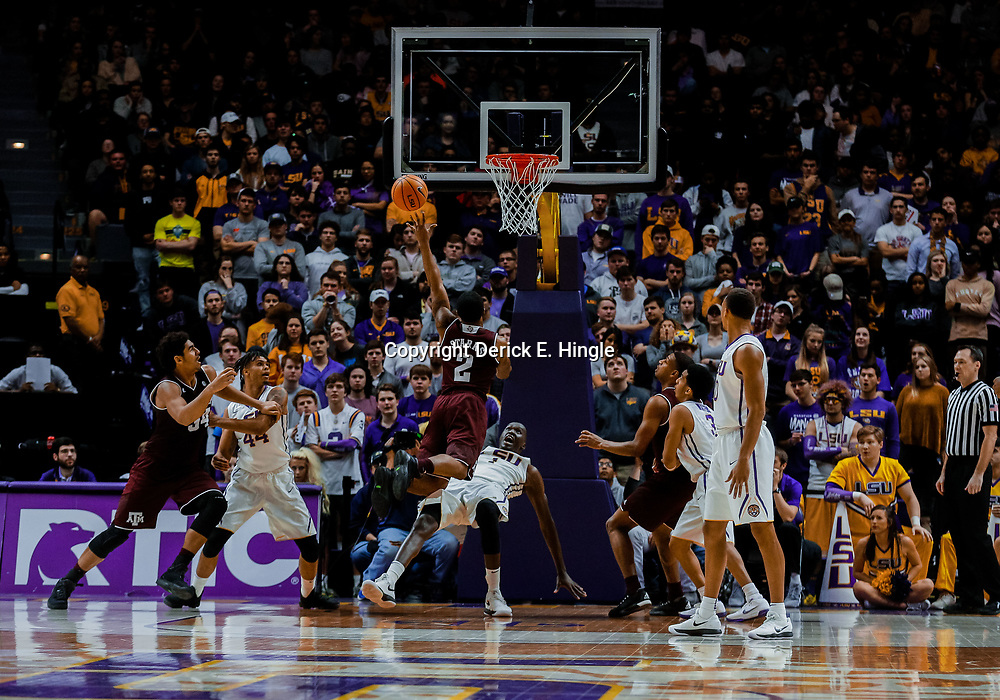 Jan 23, 2018; Baton Rouge, LA, USA; Texas A&M Aggies guard TJ Starks (2) commits a charging foul against LSU Tigers forward Duop Reath (1) during the second half at the Pete Maravich Assembly Center. LSU defeated Texas A&M 77-65. Mandatory Credit: Derick E. Hingle-USA TODAY Sports