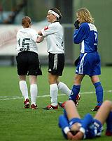 Fotball<br /> Toppserien <br /> Asker v Medkila 5-0<br /> Kadettangen kunstgress<br /> 27.04.2004<br /> Foto: Morten Olsen, Digitalsport<br /> <br /> Kjersti Thun gratuleres av Lisa-Marie Woods