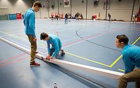 ARNHEM -  ILLUSTRATIE - het leggen van de balken tijdens de eerste dag van de zaalhockey competitie in de hoofdklasse, seizoen 2013/2014. COPYRIGHT KOEN SUYK