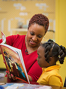 Read Houston Read volunteer Fatima Barnett works with a student at Woodson Elementary School, November 18, 2014.