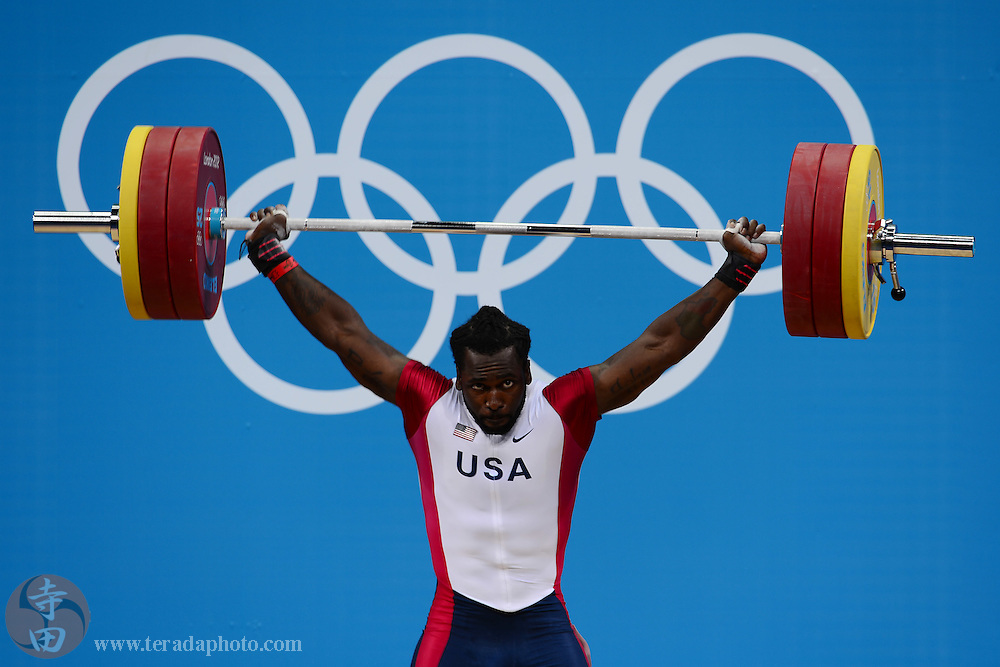 Aug 3, 2012; London, United Kingdom; Kendrick Farris (USA) attempts his third lift of snatch in the weightlifting men's 85kg group B during the London 2012 Olympic Games at ExCeL - South Arena 3.