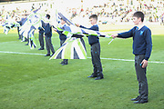 Rednock school flag bearers during the EFL Sky Bet League 2 second leg Play Off match between Forest Green Rovers and Tranmere Rovers at the New Lawn, Forest Green, United Kingdom on 13 May 2019.