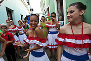 Dancers parade through the streets of Old San Juan during the Festival of San Sebastian in San Juan, Puerto Rico.