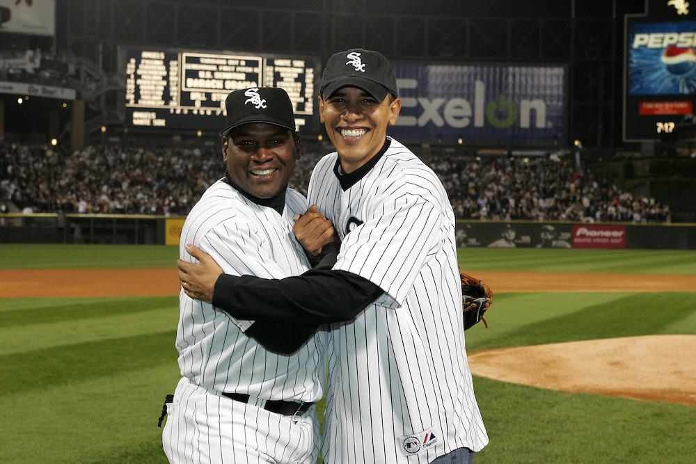 CHICAGO - OCTOBER 12:  Future United States President (then Senator) Barack Obama meets with White Sox coach Tim Raines after throwing out the ceremonial first pitch prior to Game 2 of the American League Championship Series between the Chicago White Sox and Los Angels Angels at U.S. Cellular Field on October 12, 2005 in Chicago, Illinois.  The White Sox defeated the Angels 2-1.