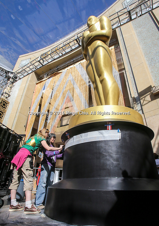 Crew members work on an Oscar Statue for the Oscars in front of the Dolby Theatre in Los Angeles, Wednesday, February 24, 2016. The 88th Academy Awards will be held Sunday, February 28, 2016. (Photo by Ringo Chiu/PHOTOFORMULA.com)<br /> <br /> Usage Notes: This content is intended for editorial use only. For other uses, additional clearances may be required.
