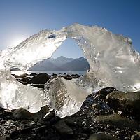 USA, Alaska, Glacier Bay National Park, Melting iceberg from Lamplugh Glacier at sunset