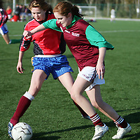 Colaiste Muire Ennistymon's Fiona Considine tries to hold off Colaiste Muire Ennis' Louise Woods during the girls soccer blitz in Lees Road on Thursday.<br /><br />Photograph by Yvonne Vaughan.