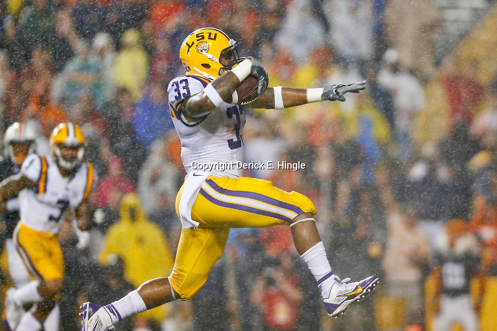Sep 21, 2013; Baton Rouge, LA, USA; LSU Tigers running back Jeremy Hill (33) scores a touchdown against the Auburn Tigers during the first quarter of a game at Tiger Stadium. Mandatory Credit: Derick E. Hingle-USA TODAY Sports