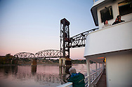 National Geographic Sea Lion's trip departing from Portland, Oregon, through the bridges and heading out towards Astoria, Oregon. Enjoying the river view as the pink sunset colors the sky and water.