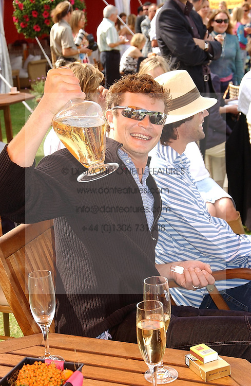 JACK KIDD at the Veuve Clicquot sponsored Gold Cup or the British Open Polo Championship won by The  Azzura polo team who beat The Dubai polo team 17-9 at Cowdray Park, West Sussex on 18th July 2004.