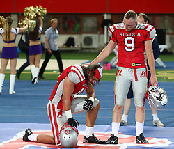 07.06.2014, Ernst Happel Stadion, Wien, AUT, American Football Europameisterschaft 2014, Finale, Oesterreich (AUT) vs Deutschland (GER), im Bild Simon Blach, (Team Austria, LB, #49) und Stefan Ruthofer, (Team Austria, DB, #9) enttaeuscht nach der Niederlage // during the American Football European Championship 2014 final game between Austria and Denmark at the Ernst Happel Stadion, Vienna, Austria on 2014/06/07. EXPA Pictures © 2014, PhotoCredit: EXPA/ Thomas Haumer
