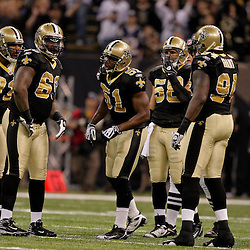 2009 November 30: New Orleans Saints defenders huddle up during a 38-17 win by the New Orleans Saints over the New England Patriots at the Louisiana Superdome in New Orleans, Louisiana.