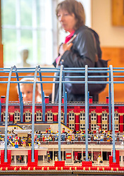 Some of the first visitors walk past one of the exhibition pieces all made entirely from Lego bricks, which goes on display to the public at the New Lanark World Heritage Village from today. <br /> <br /> &copy; Dave Johnston/ EEm