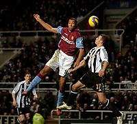 Photo: Jed Wee.<br /> Newcastle United v Aston Villa. The Barclays Premiership. 31/01/2007.<br /> <br /> Aston Villa's John Carew (L) sends a header towards goal.
