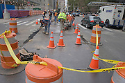 construction workers repair a street New York City