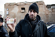 SYRIA - Al Qsair. A Syrian Army defectors, actually member of Free Syrian Army,shows his military ID on January 28, 2012. Al Qsair is a small town of 40000 inhabitants, located 25Km south-west of Homs. The town is besieged since the beginning of November and so far it counts 65 dead. ALESSIO ROMENZI