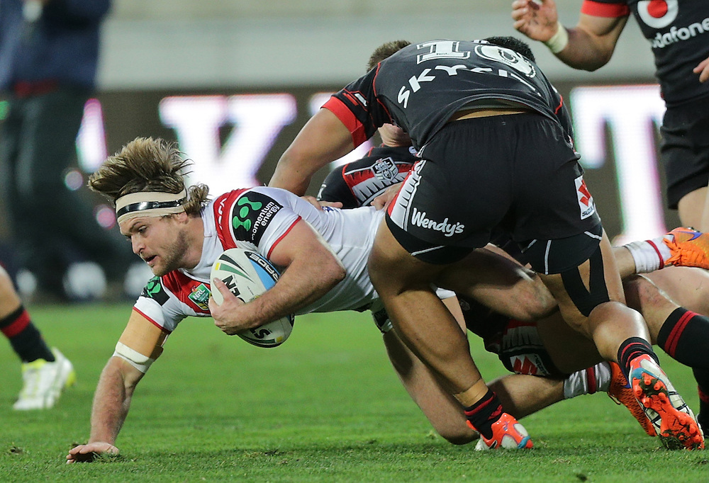 Mitch Rein of the Dragons is tackled by Albert Vete of the New Zealand Warriors during their round 22 NRL match at Westpac  Stadium, Wellington on  Saturday, August 08, 2015. Credit: SNPA / David Rowland