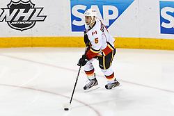 Jan 17, 2012; San Jose, CA, USA; Calgary Flames defenseman Mark Giordano (5) skates with the puck against the San Jose Sharks during the third period at HP Pavilion. San Jose defeated Calgary 2-1 in shootouts. Mandatory Credit: Jason O. Watson-US PRESSWIRE