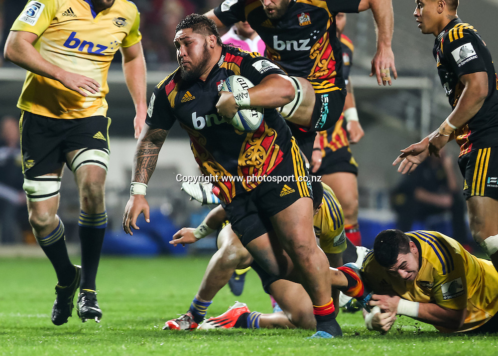 Chiefs' Ben Tameifuna charges through the Hurricanes defense during the Super 15 Rugby match - Chiefs v Hurricanes at Waikato Stadium, Hamilton, New Zealand on Friday 4 July 2014.  Photo:  Bruce Lim / www.photosport.co.nz