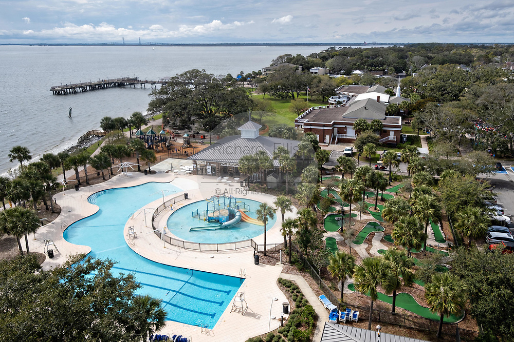 View of the pier and public pool from the St. Simons Lighthouse at Coupers Point along the Saint Simons Sound in St. Simons Island, Georgia. The working lighthouse was built in first constructed in 1807 but destroyed by Confederate forces in 1862 before being rebuilt in 1872.