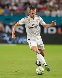 July 31, 2018 - Miami Gardens, FL, USA - Real Madrid forward Gareth Bale (11) controls the ball during the first half against Manchester United during International Champions Cup action at Hard Rock Stadium in Miami Gardens, Fla., on Tuesday, July 31, 2018. Manchester United won, 2-1. (Credit Image: © Sam Navarro/TNS via ZUMA Wire)