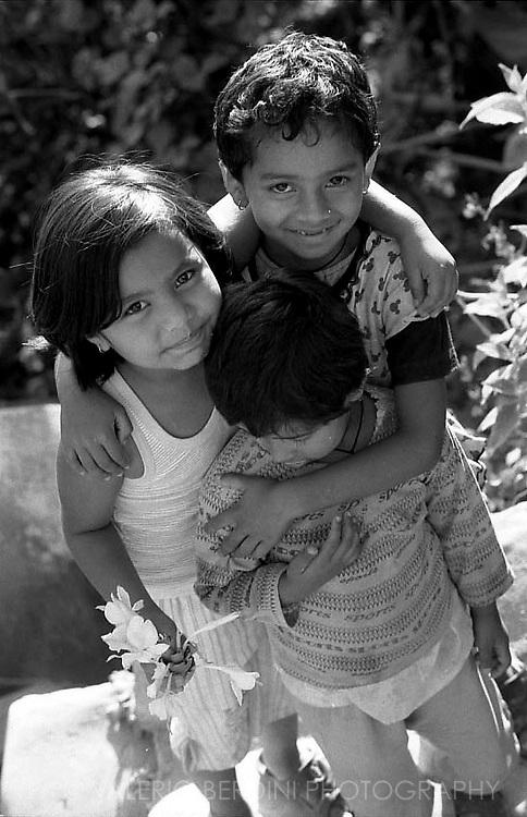 Three brothers hug