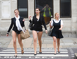 © Licensed to London News Pictures. 27/10/2011. London, UK. Photo Call -  A workman takes a photograph of models wearing their skirts tucked in to their knickers or forgetting to wear trousers outside St Paul's Cathedral, London today to promote credit reports with Experian Credit Expert, urging people to check their 'financial health' before Christmas. Photo credit : Ben Cawthra/LNP