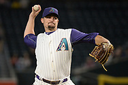PHOENIX, AZ - SEPTEMBER 14:  Zack Godley #52 of the Arizona Diamondbacks delivers a pitch in the MLB game against the Colorado Rockies at Chase Field on September 14, 2017 in Phoenix, Arizona.  (Photo by Jennifer Stewart/Getty Images)
