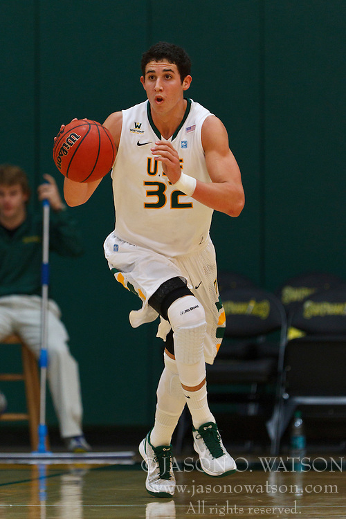 Nov 16, 2011; San Francisco CA, USA;  San Francisco Dons forward Angelo Caloiaro (32) dribbles up court against the San Jose State Spartans during the first half at War Memorial Gym.  Mandatory Credit: Jason O. Watson-US PRESSWIRE