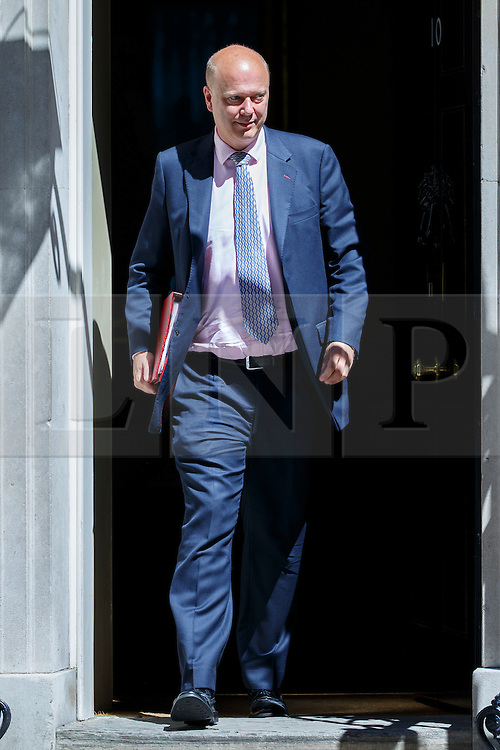 © Licensed to London News Pictures. 19/07/2016. London, UK. Transport Secretary CHRIS GRAYLING attends the first cabinet meeting under Theresa May's leadership in Downing Street on Tuesday, 19 July 2016. Photo credit: Tolga Akmen/LNP