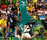 USA's Matt Scott (9) waves to Brazil's Junior da Silva (15) before helping him up during the Men's Wheelchair Basketball match between USA and Brazil in the Rio Olympic Arena at the Rio 2016 Paralympic Games in Rio de Janeiro, Brazil, on Thursday, September 8, 2016. USA went on to win the match 75-38. (Casey Sykes/University of Georgia via AP)