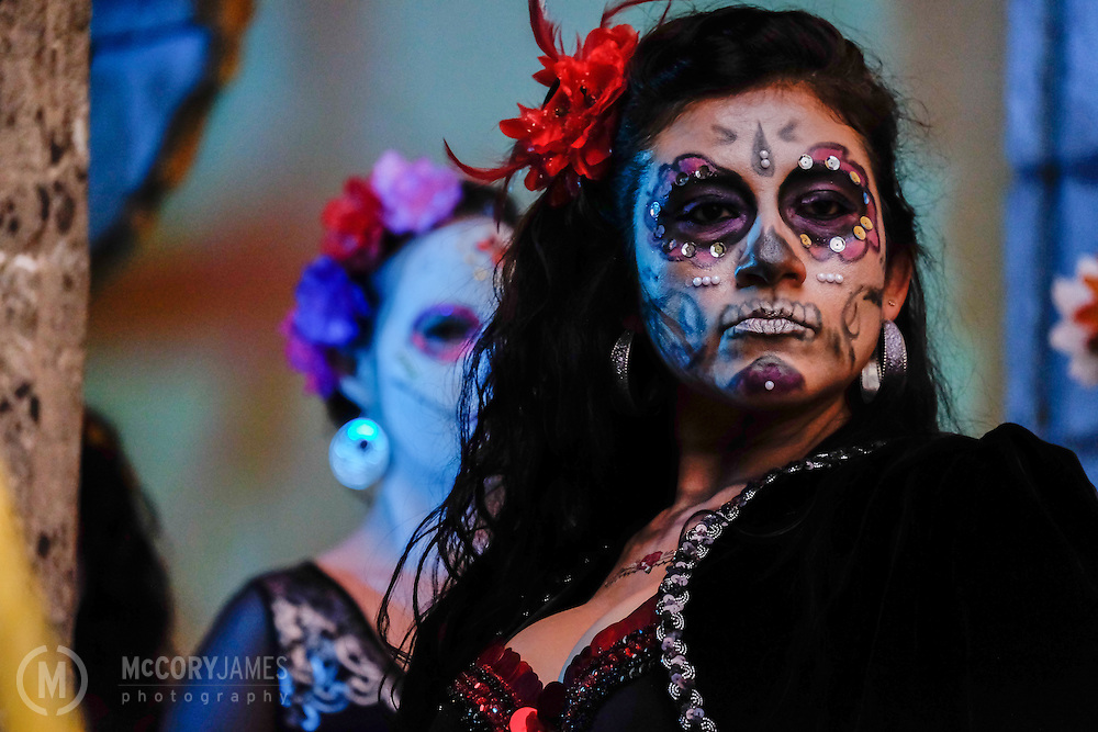 A dancer waits for her performance during Dia de los Muertos