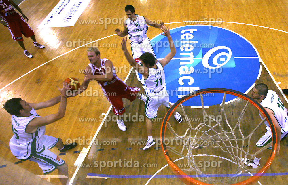 Anton Pnkrashov of Russia between Erazem Lorbek, Domen Lorbek and Goran Dragic of Slovenia at friendly basketball match before European Championships in Poland between National Teams od Slovenia and Russia,  on August 9, 2009, in Arena Tivoli, Ljubljana, Slovenia. (Photo by Vid Ponikvar / Sportida)