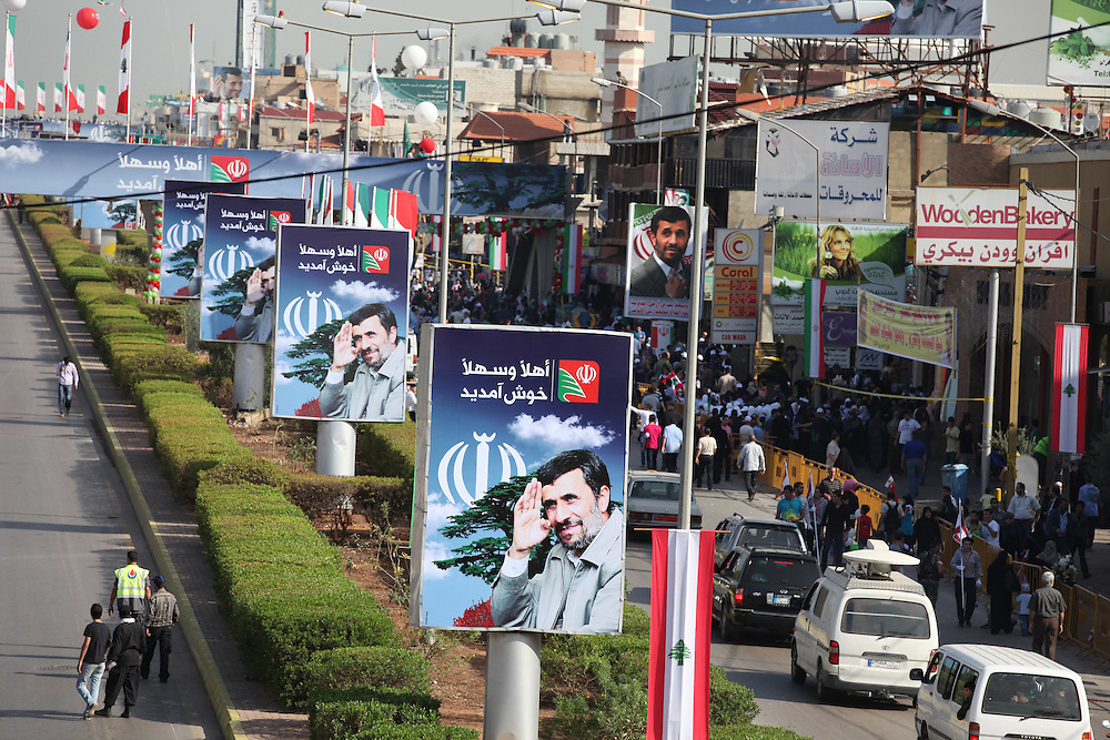 Signs and flags line Beirut's street welcoming Iranian President Mahmoud Ahmadinejad to Beirut.