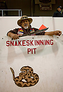 Cecil Villa who has volunteered for the past forty years as a snake processor poses in the skinning pit during the 51st Annual Sweetwater Texas Rattlesnake Round-Up March 13, 2009 in Sweetwater, Texas. During the three-day event approximately 240,000 pounds of rattlesnake will be collected, milked and served to support charity.