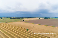 63801-14317 Aerial view of combine harvesting wheat ahead of a thunderstorm Marion Co. IL