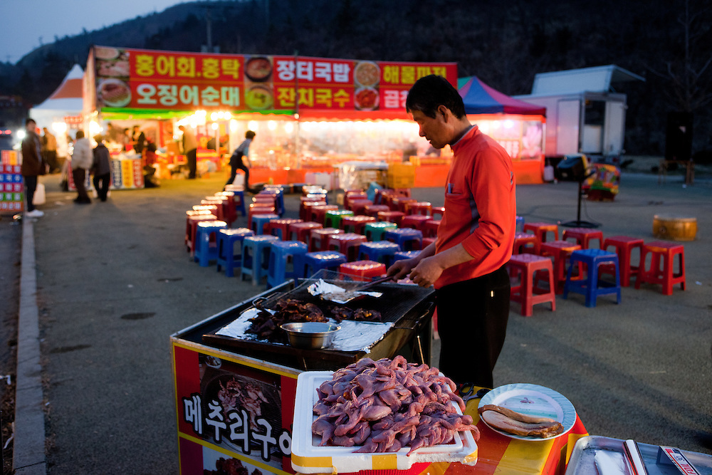 """Restaurant tent in Hoedong (Jindo island). Jindo is the 3rd biggest island in South Korea located in the South-West end of the country  and famous for the """"Mysterious Sea Route"""" or """"Moses Miracle"""" which is happening during full moon in spring."""