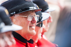 London, June 23rd 2014. A Chelsea Pensioner listens to speakers as members and veterans of the armed forces gather at City Hall for a flag raising ceremony to mark Armed Forces Day