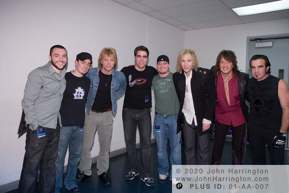 Emo rockers Honor by August pose with Bon Jovi on Saturday December 17, 2005.