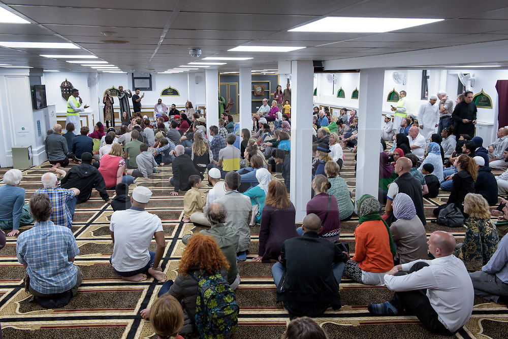 © Licensed to London News Pictures.  22/06/2017; Bristol, UK. Inside the Easton Jamia Masjid Mosque at 'The Big Iftar 2017' in St Marks Road, Easton, Bristol, marking the end of the muslim holy month of Ramadan when muslims fast from dawn until sunset. It is believed this is the first time in the UK that the event includes a meal held in the street and shared with all communities including non-muslims. It is hosted by Easton Jamia Masjid with partners including Bristol4Muslims, we care foundation, Karam Kitchen, and aims to bring people from different backgrounds and cultures together to share good food and learn from each other. Ramadan is a month of sharing, hospitality, charity giving and creating new friendships, and the Big Iftar is a great way of achieving these goals while breaking down barriers that may exist within communities. Visitors were also given a grand tour to the newely refurbished mosque located in the heart of Easton. Picture credit : Simon Chapman/LNP