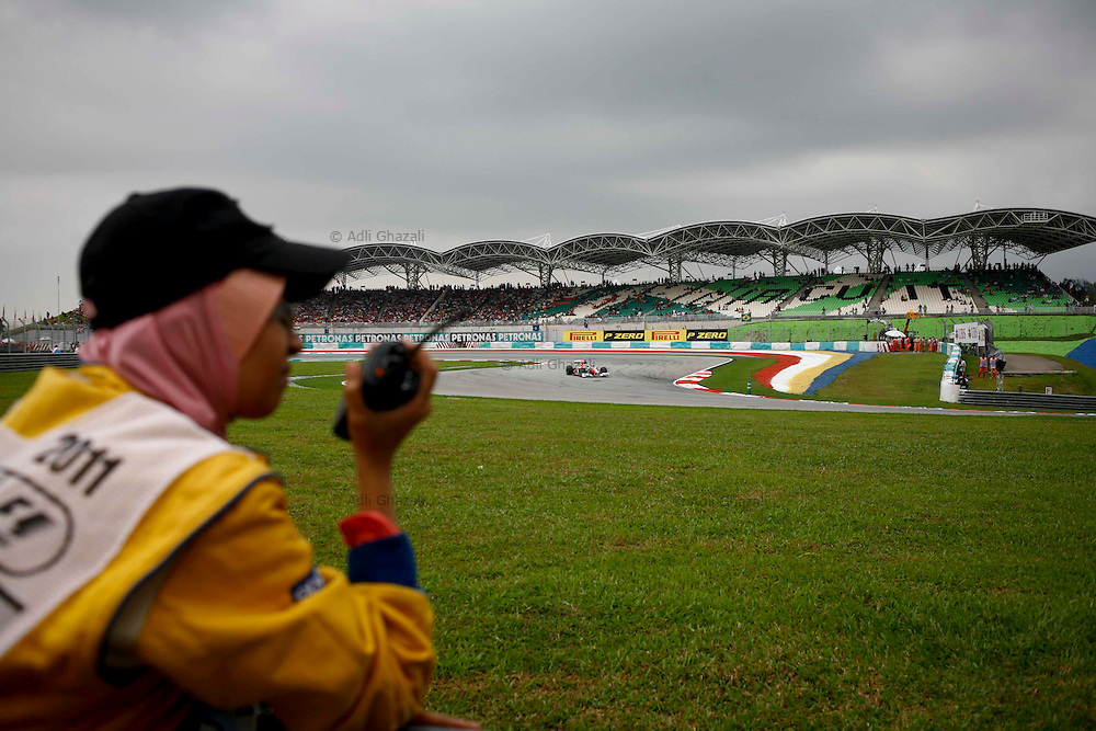 Track marshaller on stand by during the Malaysian Formula One Grand Prix in Sepang, Malaysia, Sunday, April 10, 2011.