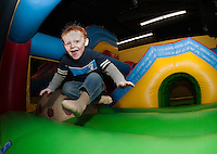 "Gavin Dunnam takes a giant jump during the first annual ""Jump a Thon"" on Sunday at Jump 'n Joy to benefit the 2012 WLNH Children's Auction.  (Karen Bobotas/for the Laconia Daily Sun)"