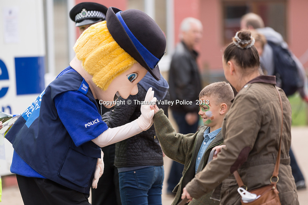 The Thames Valley Police Mascots, PCSOs Proud and Respect, were a hit with visitors to the Berkshire College of Agriculture Open Day this weekend, as they greeted passers-by and 'high-fived' them. The two characters were there to support officers in the Neighbourhood Policing Team, who were promoting Thames Valley Alert from a mobile police station. <br /> Thames Valley Alert is a community messaging system that provides localised crime and safety alerts for residents and businesses throughout the Thames Valley policing area.   Maidenhead, UNITED KINGDOM. April 28 2013. <br /> Photo Credit: MDOC/Thames Valley Police<br /> &copy; Thames Valley Police 2013. All Rights Reserved. See instructions.