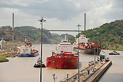 Cargo ships arriving to Pedro Miguel Locks. Panama Canal, Panama City, Panama, Central America.