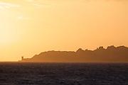 A Genovan tower at the limestone cliffs near Bonifacio at sunset.