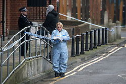 © Licensed to London News Pictures. 09/01/2018. London, UK. Police and forensics talk to a local resident at the scene in Stoke Newington where a 34 year old man has died after being assaulted. Officers arrived and found the victim suffering from stab injuries. He was taken to an east London hospital by ambulance where he died just before midnight on 8/1/2018. A murder investigation has been launched. Photo credit: Ben Cawthra/LNP