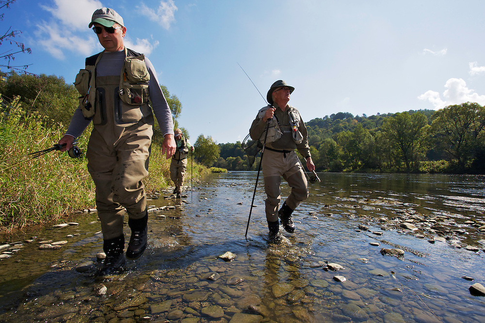 Jeremy Lucas (Pioneer Flyfishing Ltd) guiding Lawrence Greasley and Stuart Crooks (behind) for Grayling (Thymallus thymallus) fishing at the San River. Myczkowce, Poland.