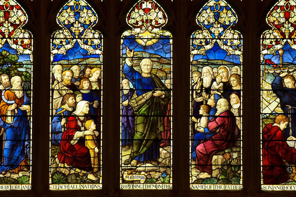 Section of the stained glass east window, dating from 1908, in Dunkeld Cathedral, Tayside, Scotland. St. Columba teaching